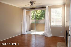 Crown molding, 2 tone paint, wood plank flooring and lots of greenery to view