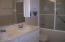 Double sinks & glass shower doors