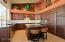 Kitchen completely remodeled in 2013 with alder cabinets, dramatic granite and high end appliances