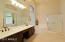 Spacious master bath with dual sinks, & private toilet room
