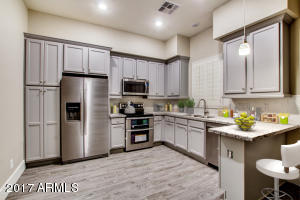 Spacious Gourmet Kitchen w/ Stainless Steel Appliances, Granite Countertops and Shaker Cabinets.