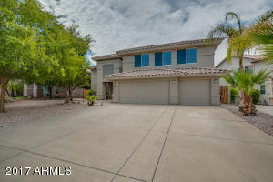 Large lot allows for a big setback from the road. Lots of driveway parking for guests, beautiful trees, low maintenance desert landscaping, fresh exterior paint.