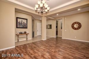 Gorgeous Wood Laminate No Scratch Flooring and Grand Dining Area greet guests.