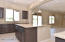 Huge Kitchen Island with Gorgeous Slab Granite Countertop