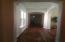 Great entry to hallway with hardwood floors