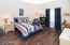 Roomy 2nd bedroom with wood looking tile floors!