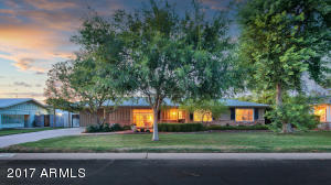 Covered 2 car carport, manicured lawns and mature landscaping on this irrigated lot.