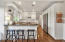 This open, bright and updated Kitchen has breakfast bar seating for 3, open shelving, crisp white cabinetry and stainless appliances.