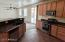 Kitchen opens to dining and living areas