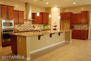 The gourmet kitchen is the heart of this home.