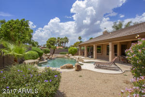 The backyard is an entertainer's dream with a full length covered patio
