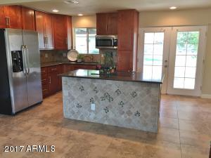 "Gorgeous remodeled kitchen! Granite counters, 40"" cabinets, stainless steel appliances, and recessed lighting"