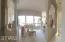 Open concept living/dining room with expansive view of backyard and Pinnacle Peak