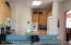 CORIAN COUNTERS, BREAKFAST BAR, ISLAND, OPEN TO FAMILY ROOM