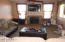 Family room features gas fireplace.