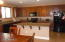 Kitchen has it's own dining area and a kitchen island/ breakfast bar.