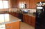 Kitchen has very nice cabinetry and a smooth-top stove.