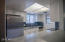 Completely NEW kitchen! New white cabinets with grey quartz countertops. Brand New tile backsplash.
