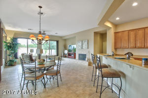 Great room has gorgeous tile, breakfast bar and eating area.