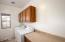 Upstairs laundry room with ample cabinets and folding space