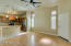 """GLEAMING LAMINATE FLOORS * FULL REMODELED KITCHEN * ISLAND * PENDANT LIGHTS * GLASS FRONT CABINETS * CEILING FAN * 4"""" BASEBOARDS * SHUTTERS"""