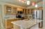 COMPLETELY REMODELED KITCHEN 2014 * SOLID WOOD CABINETS * SLAB GRANITE COUNTER TOPS * ALL STAINLESS STEEL APPLIANCES * ISLAND * PENDANT LIGHTING * REFRIGERATOR INCLUDED