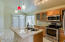 KITCHEN ISLAND * PENDANT LIGHTING * BUILT-IN MICROWAVE * SMOOTH TOP STOVE *