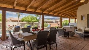 spacious covered patio serves as outdoor living room