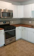 Stainless appliances and butcher block countertops