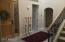 1/2 bath thru arch, door to laundry and garage