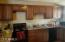 Large kitchen with upgraded maple cabinets and granite counters