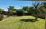 LARGE GRASS BACKYARD WITH IRRIGATION & ALSO HAS SPRINKLERS & TIMER