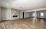Living area facing front of property w/Gas fireplace dining room area. T