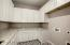 Separate large laundry room with plenty of storage.
