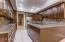 Expansive granite countertops and refinished cabinets.