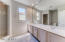 Dual sink vanities with new toilet in your 3rd master bath suite.