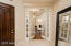 Beveled glass doors give privacy to the den.