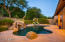 Splash around in the pool with a relaxing waterfall feature.