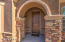 Arched entry leads to the front door.