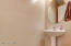 Half bath is located in the hallway conencting the kitchen to the formal sitting/family room.