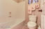 Jack-and-jill bathroom is a full bath. Shower/tub and toilet are separated from the sinks by a door.