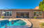 Walk out from the living room, onto the covered patio, and then straight in to the pool.