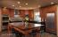 Kitchen features Sub-Zero, Miele, Wolf appliances.