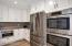 Bosh Stainless Refrigerator,Double Ovens, Sharp Microwave with recessed, hidden auto open.. close.