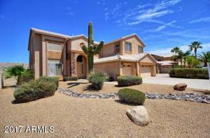 Stacked Stone Entry, Low Maintenance Desert Landscaping, South Facing Large Lot.