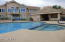 Common pool & spa with boat dock, bathrooms and outdoor kitchen