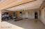 Garage has epoxy floors, cabinets, workshop.