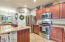 Stainless steel appliances including a gas stove.