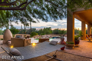 Backyard retreat offers a pool/spa, BBQ, fireplace on a private 1 acre lot with north/south exposure.