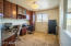 Featuring custom built in office-center/cabinets